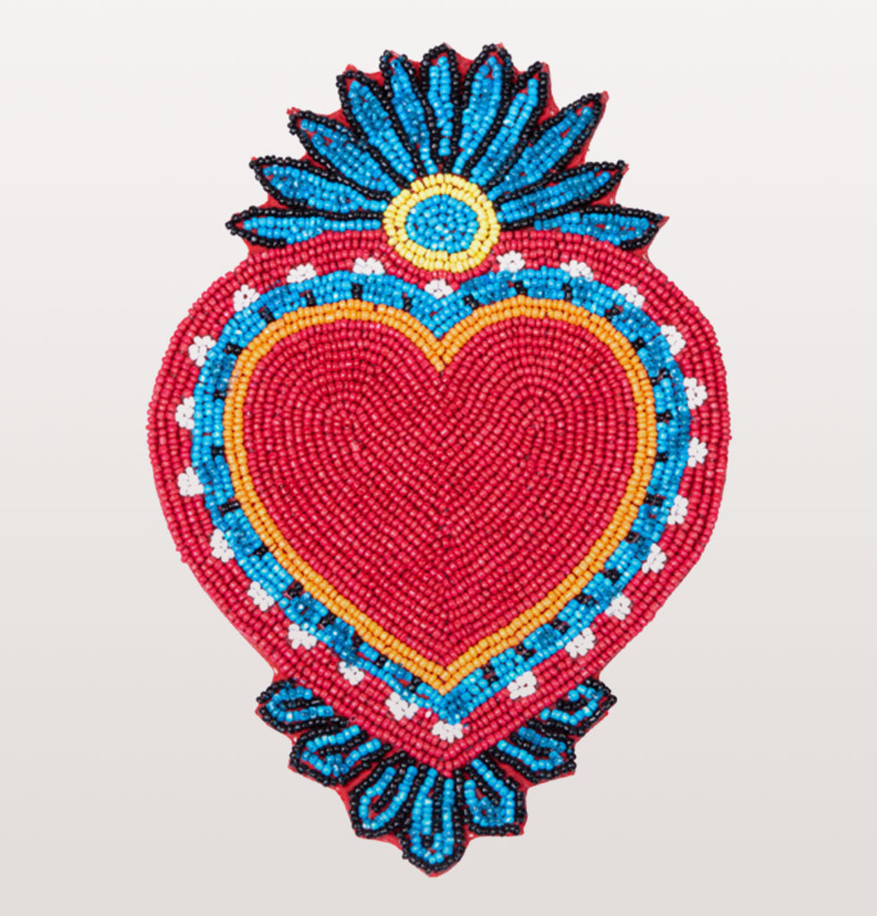 Pedro Candle Set  Divertido! Pedro the dancing candleholder has been paired with our beautiful hand made blue daisy pillar candle and this beautiful protective Mexican milagros heart shaped coaster for the ultimate finishing display for your table.  Pedro Holders Hand made Blue Daisy Pillar Candle Red and blue heart shaped milagro display coaster