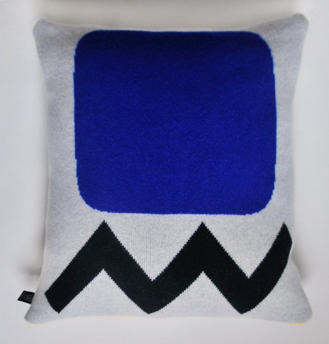 GIANNINA CAPITANI, knitted cushion. blue square, black zig zag print. Made in Britain, lambswool, duck feather pillow