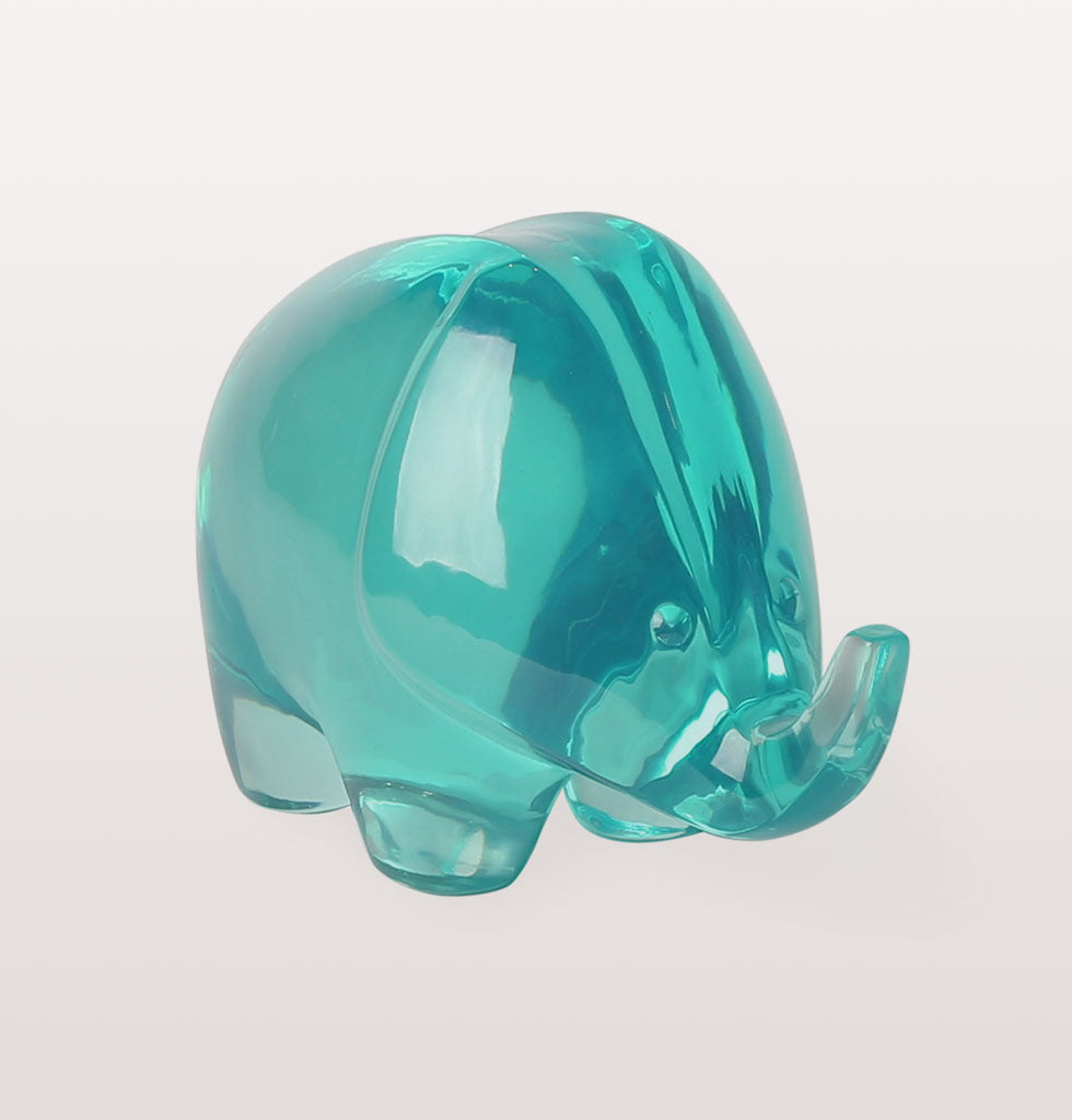 large acrylic green elephant sculpture by Jonathan Adler. Jungle lucite celedon green elephant