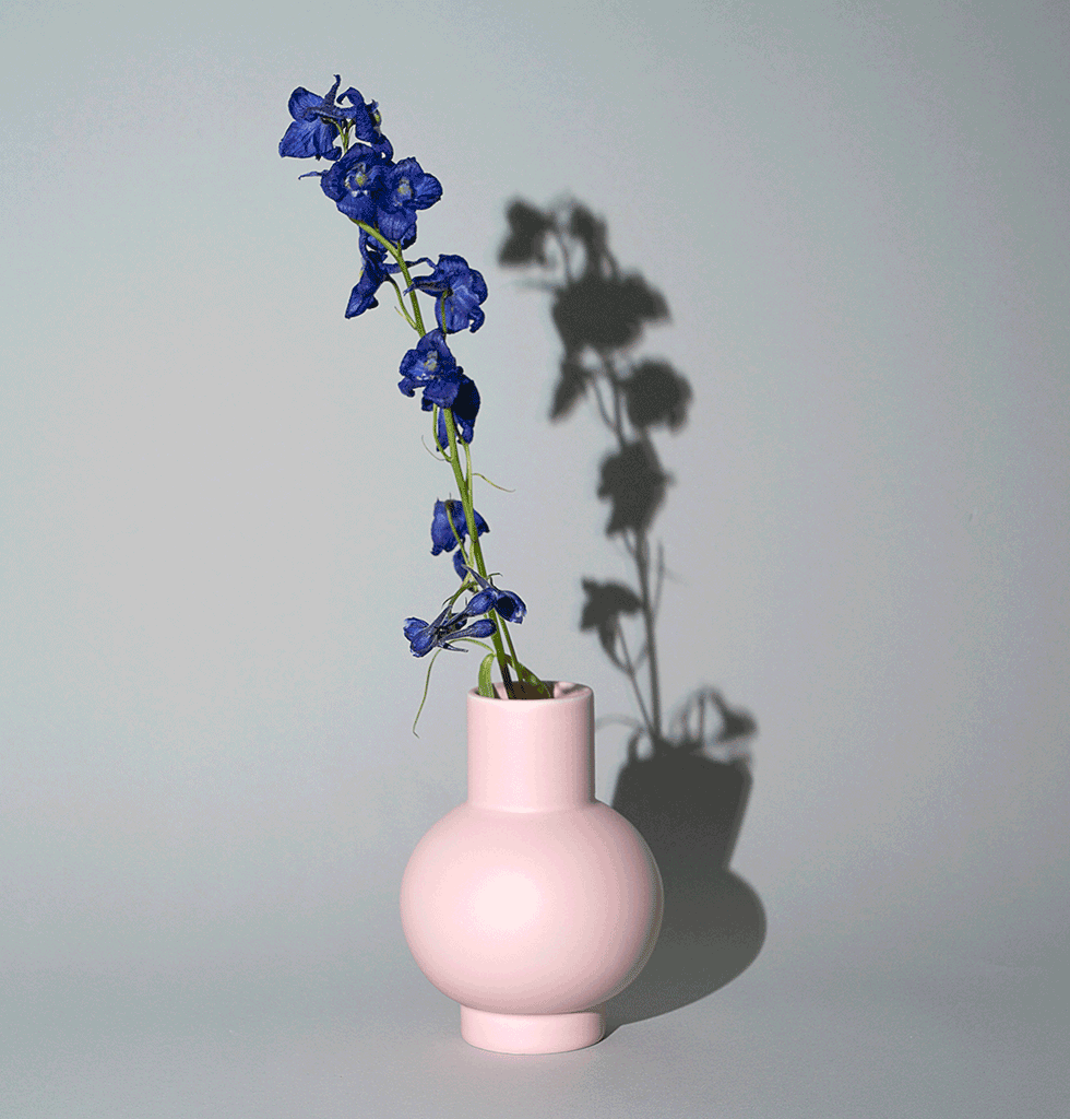Small pink ceramic vase by Raawii Strom collection with flower