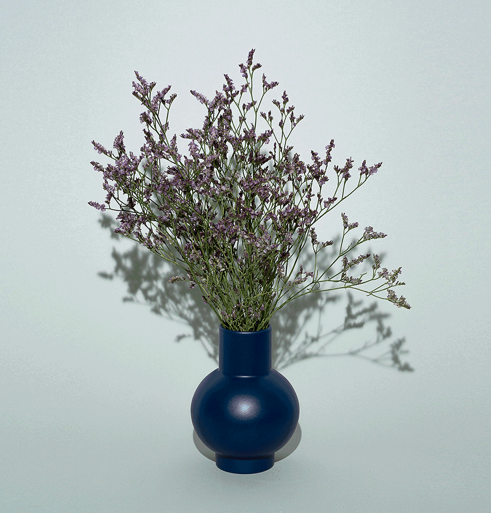 Small navy blue ceramic vase by Raawii Strom
