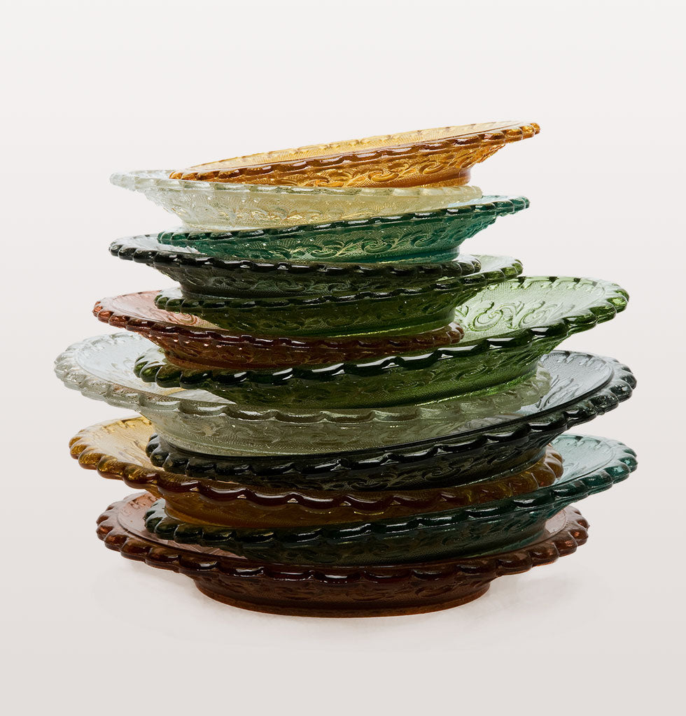 Coloured glass makes for the most prettiest of tablescapes and these traditional Portuguese fleur de lays pattern side plates are the real deal.  Transparent glass side plates for perfect summer dining. Use for seafood, salads, desert and cake. Set includes one plate of each colour: Amber Yellow, Pink, Blue and Green