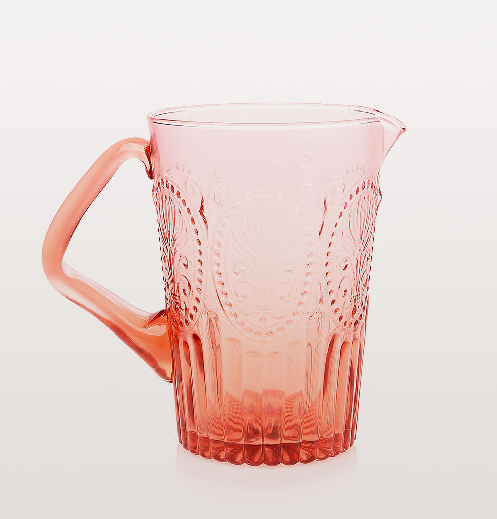 Traditional coloured glass patterned jugs from Portugal. Pretty jug for festive table or summer garden party. Perfect for water, flowers or Sangria. Portuguese fleur de lys pattern artisan glassware. Coloured handle and stunning design for unique coloured glassware. Available in yellow, pink, amber and champagne.