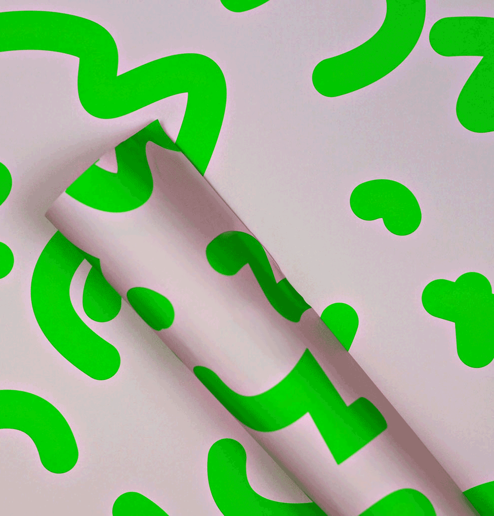 The Completist pale pink and bright neon green premium wrapping paper.