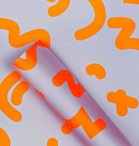 The Completist pale pink and bright neon orange premium wrapping paper.