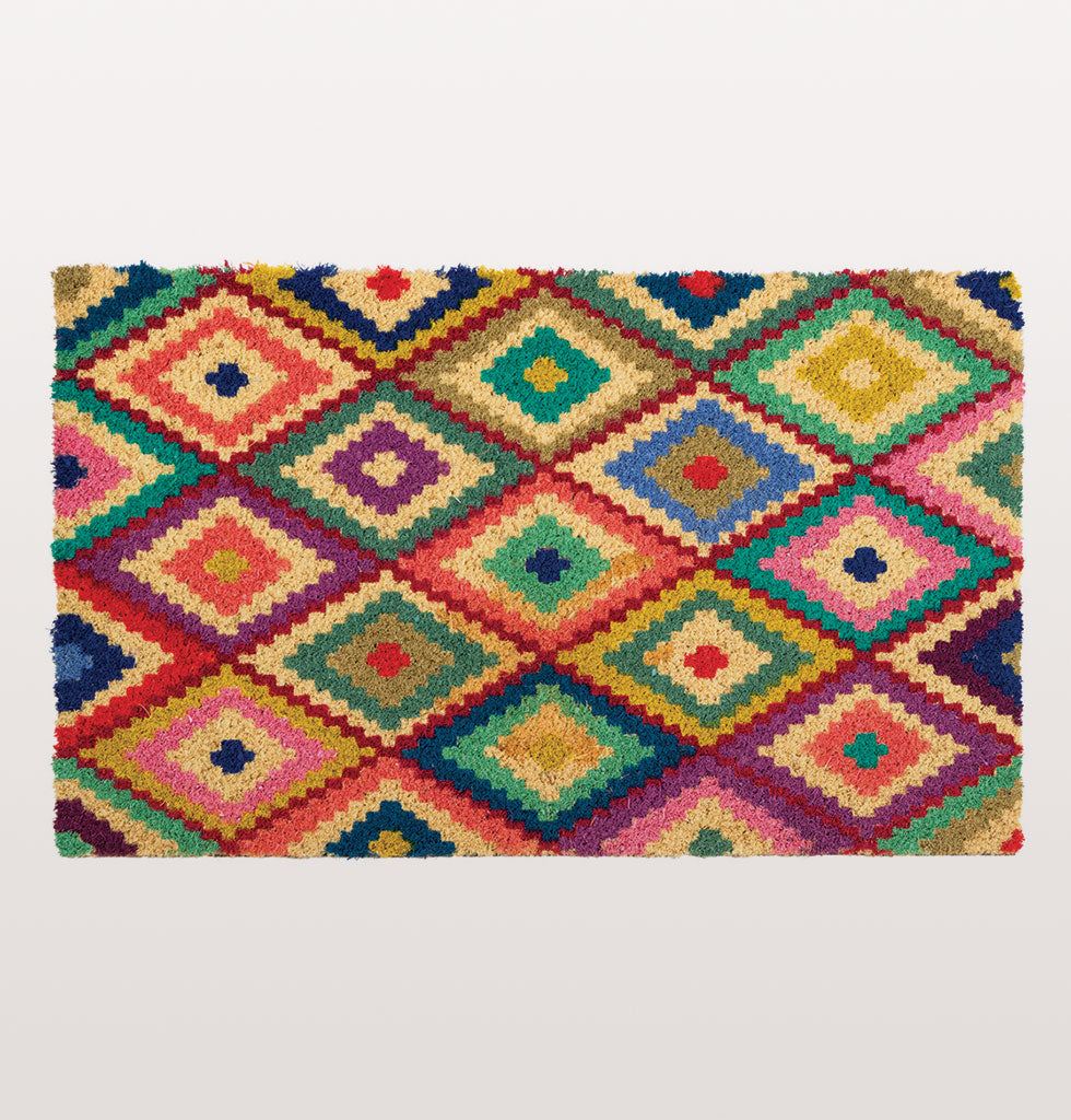 W.A.GREEN | KITSCH KITCHEN | Kellim Doormat. £33. At last a door mat to match your stunning interior. Inspired by the pattern of a Kelim rug this bright rainbow diamond pattern is a pretty welcome for your home.  Bold and modern multi coloured door mat in natural coconut fibre.