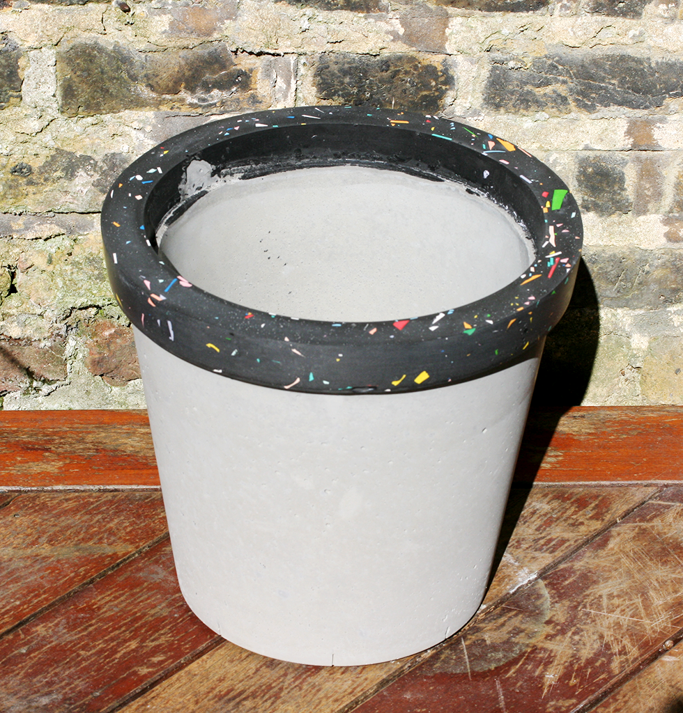 Concrete Candy jumbo concrete planters with black tutti frutti terrazzo. £96 wagreen.co.uk