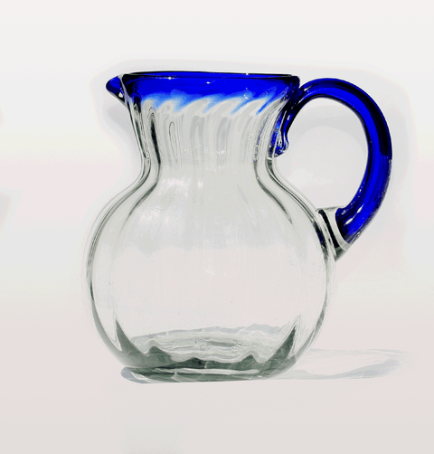 MEXICAN ROUND JUG WITH BLUE RIM AND RIBBED GLASS MILAGROS