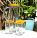 MEXICAN CLEAR TALL GLASS JUG BY MILAGROS WITH YELLOW RIM AND MATCHING YELLOW RIM DRINKING GLASS TUMBLERS