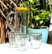 MEXICAN CLEAR TALL GLASS JUG BY MILAGROS WITH YELLOW RIM AND CLEAR RIBBED GLASS TUMBLERS