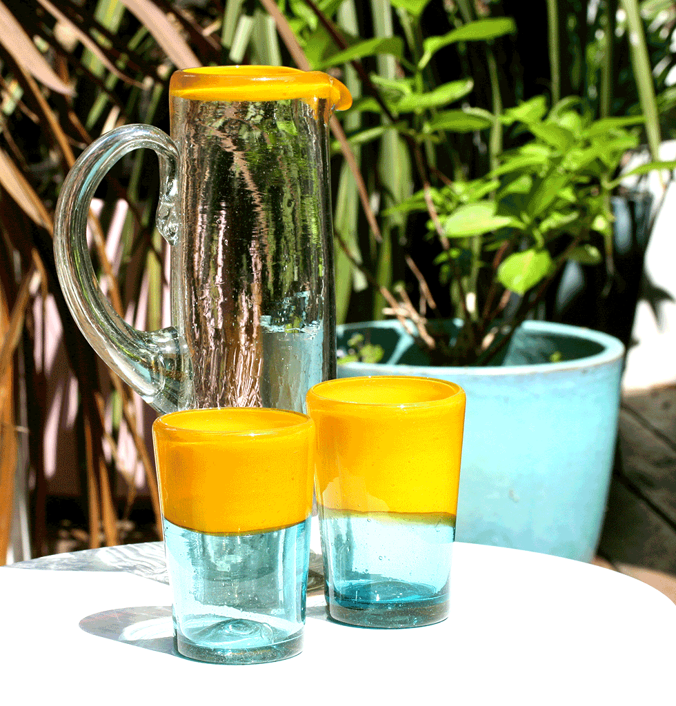 MEXICAN CLEAR TALL GLASS JUG BY MILAGROS WITH YELLOW RIM AND YELLOW AND TURQUOISE BLUE TUMBLERS