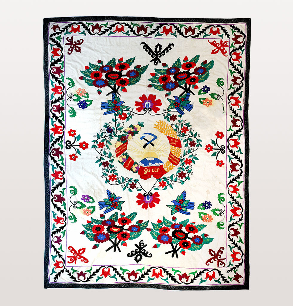 Vintage suzani Soviet Union wall hanging. Features folk birds and flowers with hand embroidered Soviet Union motif in the centre with hammer and sickle and Uzbekistan writing.