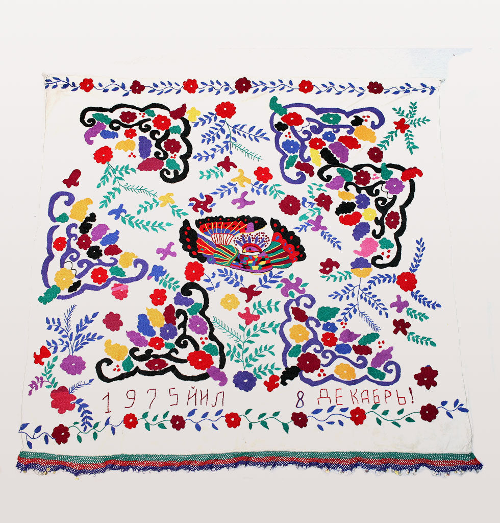 Vintage suzanis from the late Soviet era 1970-1980 featuring embroidered flowers and a folk art bird. Decorated by hand in purple and red flowers