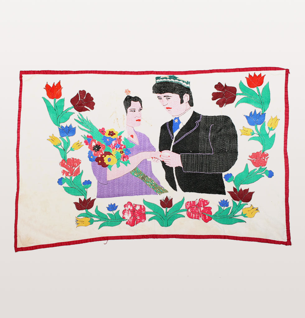 WEDDING COUPLE SUZANI. TRADITIONAL SOVIET ERA SUZANI. 1970 - 1980 EMBROIDERED SUZANI FEATURING COUPLE AND FLORAL FOLK ART DESIGN.