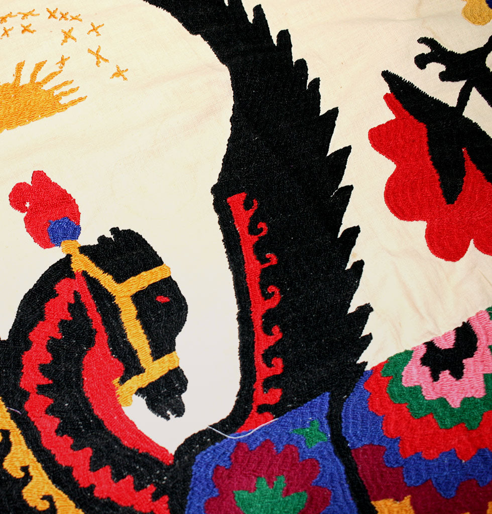 Pegasus detail on giant hand stitched wall tapestry from Uzbekistan. Soviet era embroidery 1970 to 1980