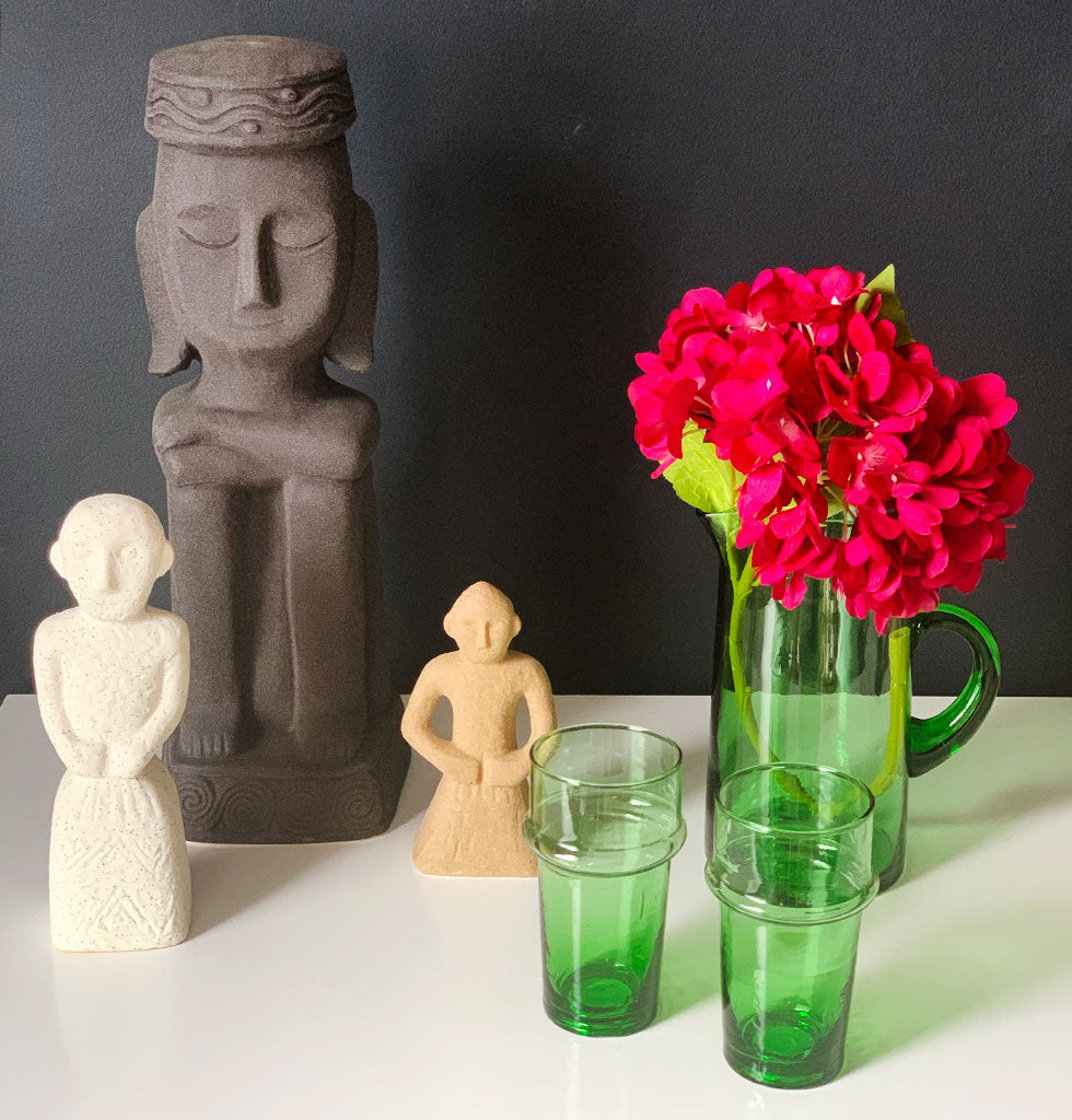 Stoneware statues by Madam Stoltz. Inca inspired statues in stone terracotta. Recycled green glass jug and Beldi glasses