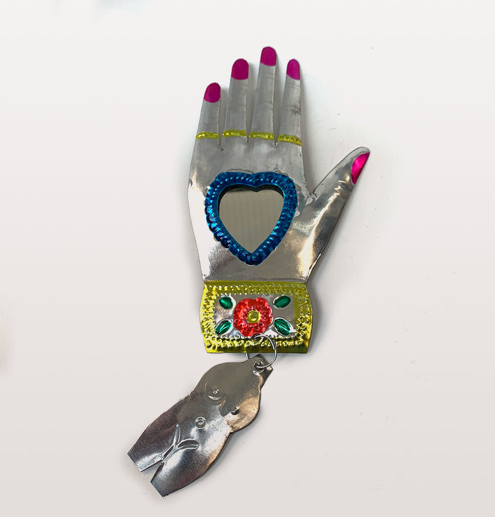 Blue heart and pink nails Mexican miracle hand mirror. £21 wagreen.co.uk