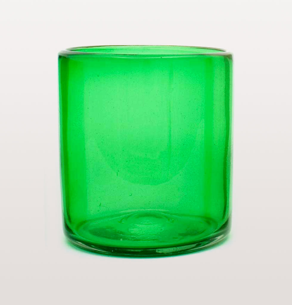"MILAGROS | MEXICAN GLASSWARE | Go green with these Mexican glasses. Made in Mexico from recycled jade green glass these heavy weight roca style low ball tumblers make the most humble drink seem extravagant.  The simple straight sided design of these bright green glasses makes drinking a pure pleasure.   W.A.Green says, ""The jade green colour brings harmony and balance to your table"".  Set of 4 jade green glasses. £29 wagreen.co.uk"