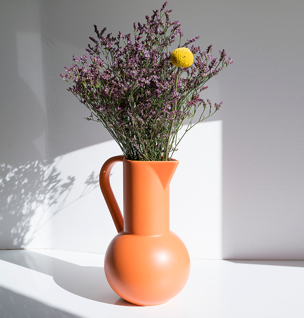 Strom bright orange ceramic large jug by Raawii with flowers. £103 wagreen.co.uk