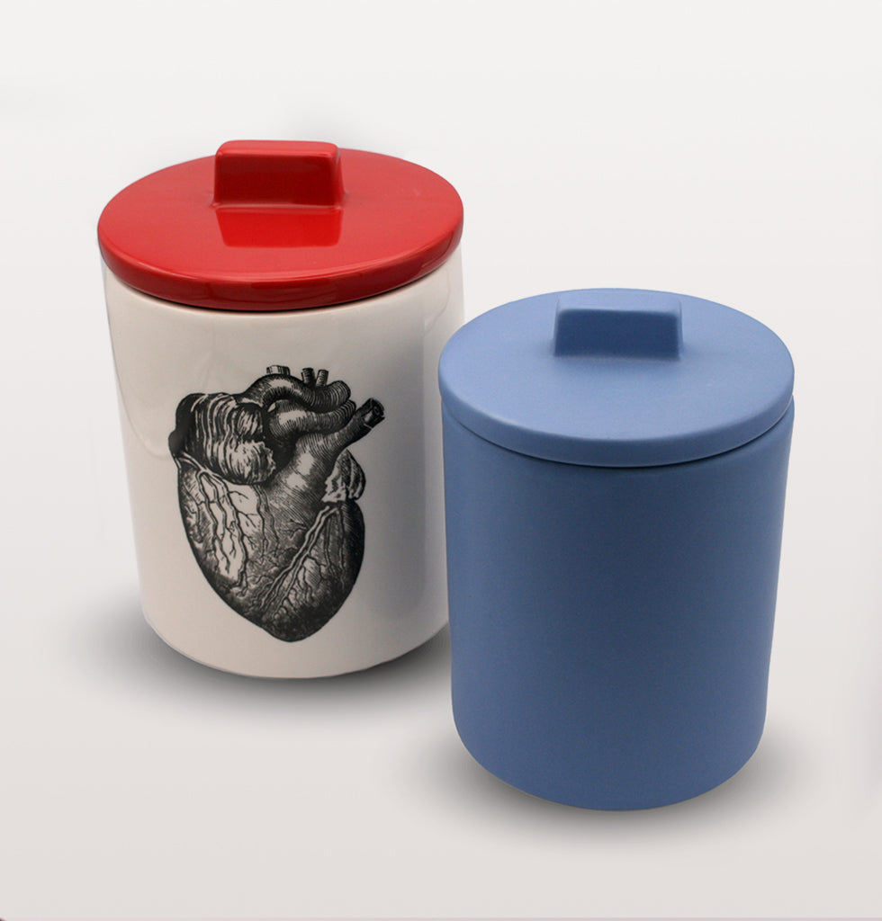 W.A.GREEN | KITSCH KITCHEN | The black and white heart design is set off against the lovely bright red lid and small blue storage jar. Medium sized storage jar. Perfect lidded jar in the kitchen for tea and coffee, in the bathroom for cotton wool pads or in the bedroom for hair bands, you'll love it. wagreen.co.uk