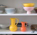 Raawii ceramics featuring yellow and pink bowl with large yellow jug and small orange jug from Strom collection
