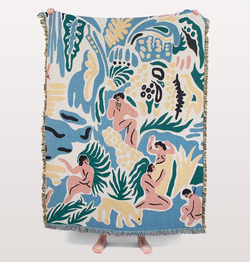 Kimbie designer blanket by Slowdown Studio with naked people in nature with green, blue and yellow. £245 wagreen.co.uk