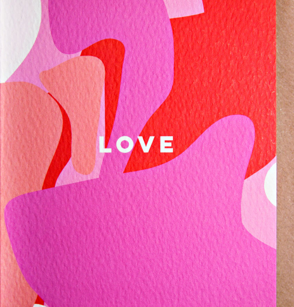 Love greetings card for Valentines or birthday or support. Bright design in pink, red and white with LOVE message on the front. Blank inside