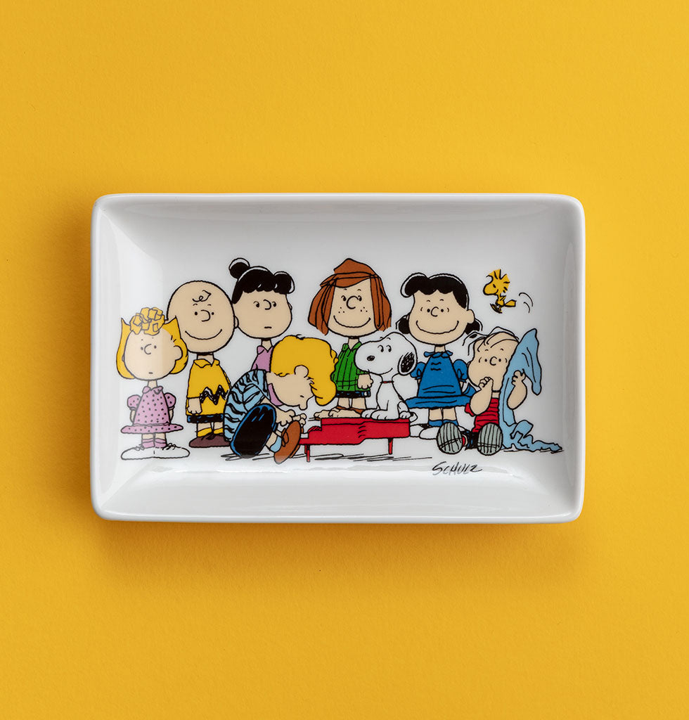 """Happiness is being one of the gang"". Peanuts ceramic trinket tray. Whole gang from cartoon Charlie Brown and Snoopy catch-all dish in smart gift box by Magpie X Peanuts. £13 wagreen.co.uk"