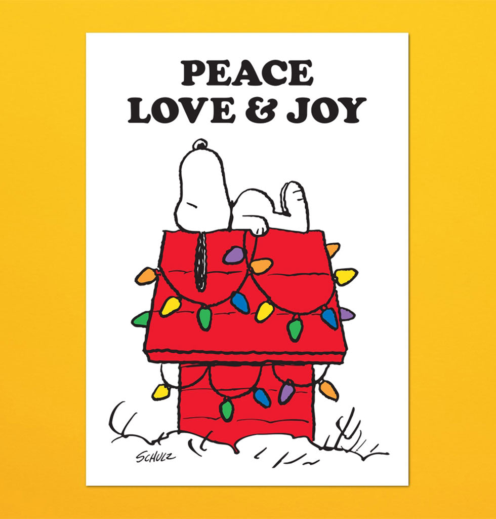 PEACE, LOVE AND JOY TEA TOWEL FEATURING SNOOPY ON HIS RED HOUSE WITH FESTIVE LIGHTS