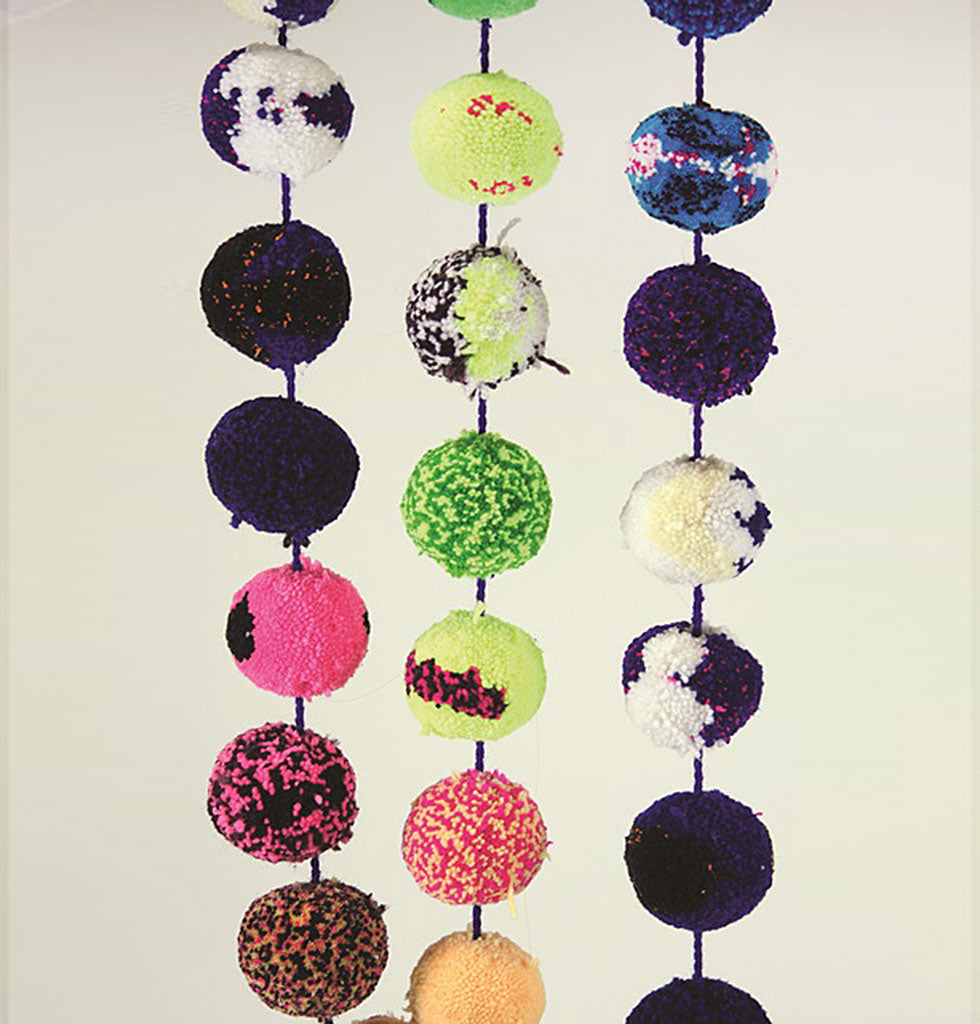 It's so fluffy! This deliciously soft giant rainbow pom pom garland is perfect for adding some festive fun to your Christmas  22 multicoloured giant pom pom balls of wool make this bright garland a real joy to behold.  Hand made in India, each garland is a unique feast for the eyes.  Size: Ø 8cm | L 160cm