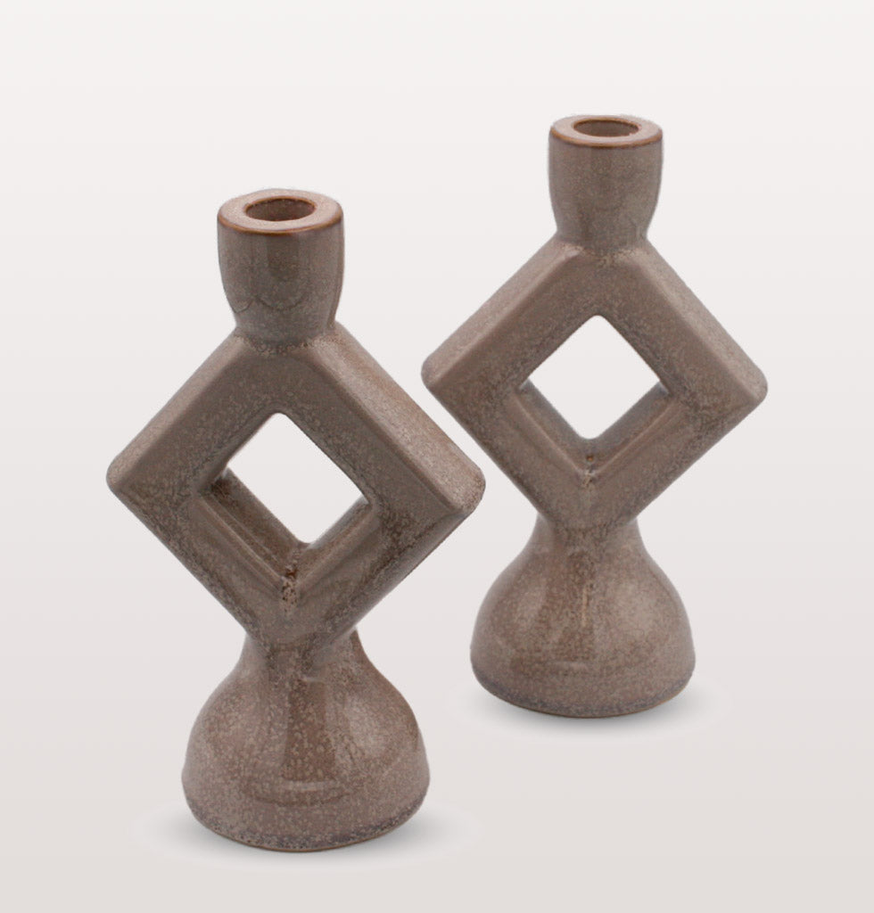 W.A.GREEN | MADAM STOLTZ | Lilac grey stoneware diamond shape candle holders. Pair of light grey candlesticks. £36 wagreen.co.uk