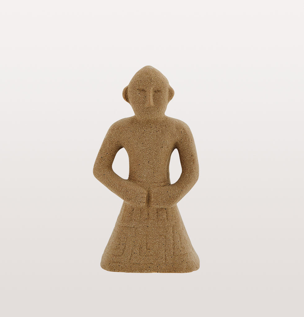 "This simple Inca inspired beige brown stoneware statue is an easy way to add some drama and show off your spirit of adventure.   Cute Peruvian style stone statue bursting with personality. Ideal decorative statuette for shelves and coffee tables.  W.A.Green says: ""This simple statue is the type of thing we like to pick up when we're on our travels""."