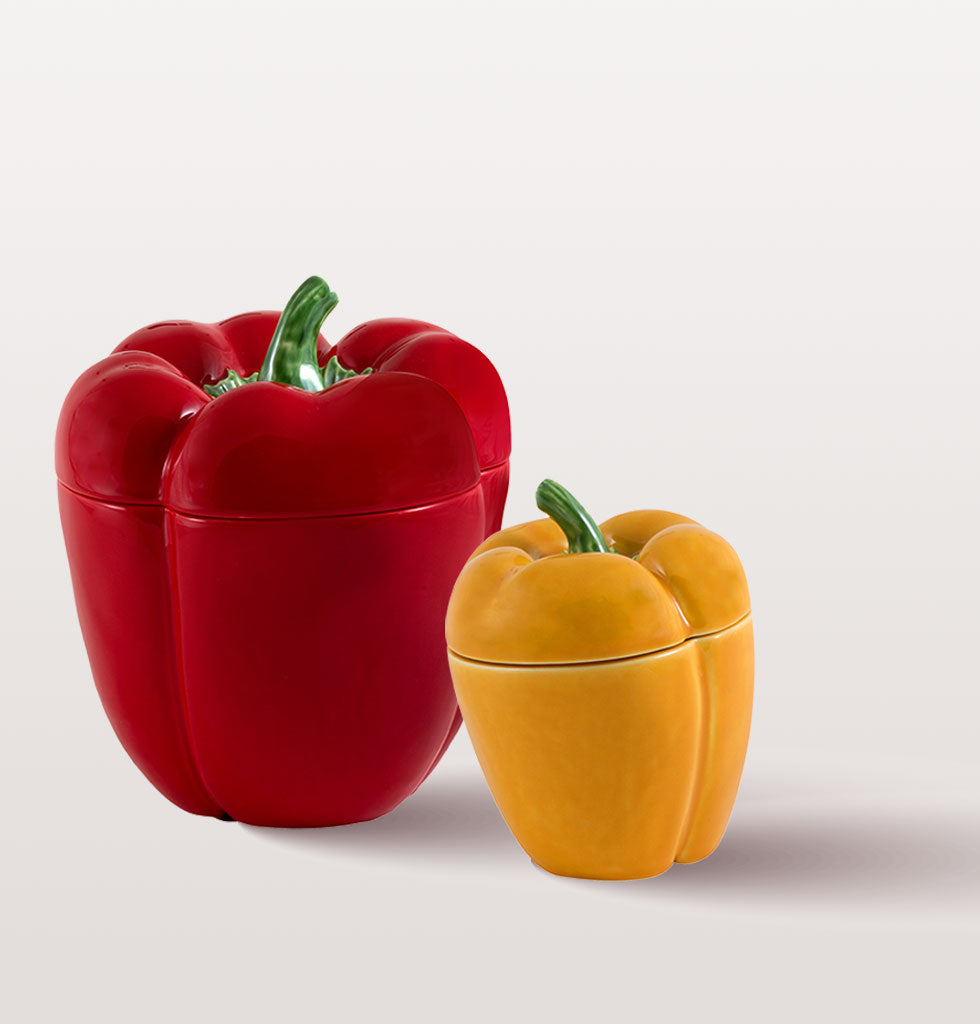 Small yellow and medium red Pimento Pepper pot by Bordallo Pinheiro. wagreen.co.uk