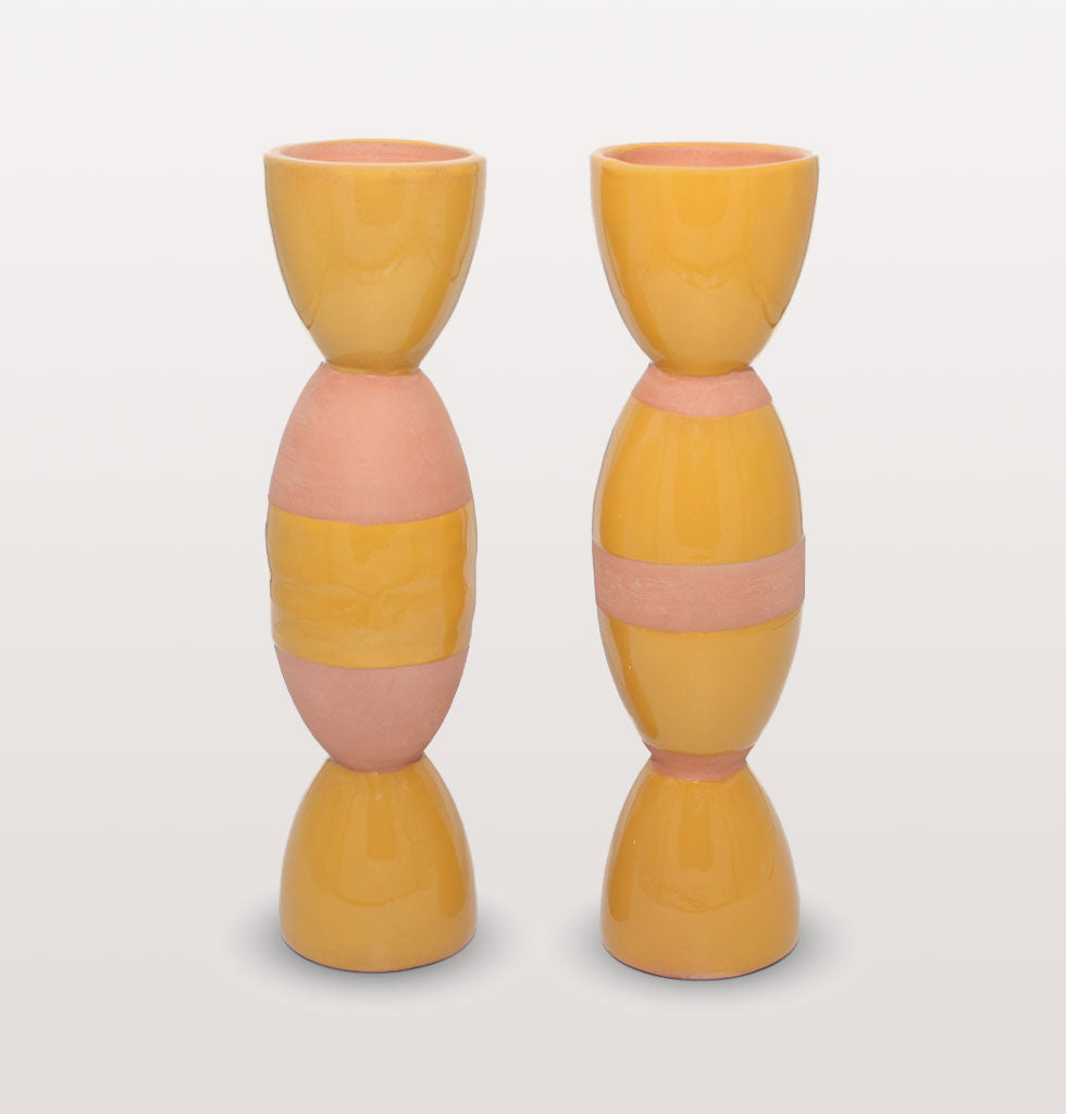 Double glazed totem mustard yellow candle holders by Tina Vaia. Easy elegance and style points for your tablescape of dreams. Tall brown and yellow striped candle holders. Produced by hand by artisans in Valencia, Spain. Limited edition. Pair of tall totem candle stick holders. £95 wagreen.co.uk