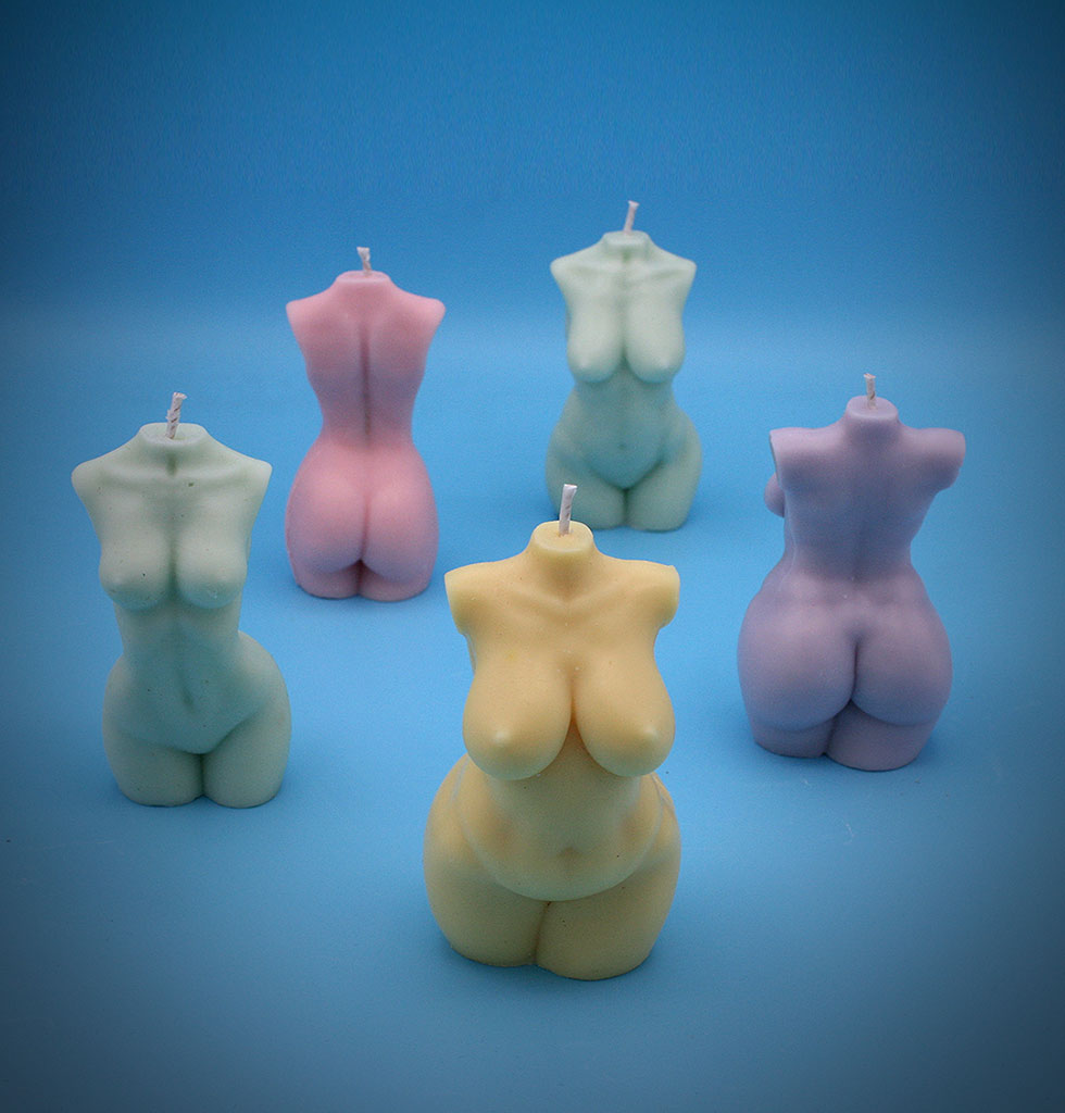 Cool girl nude body candles. Pastel pink, lemon yellow, green and blue female body candle with wick. Hand poured vegan and eco friendly. Made in UK. £24 wagreen.co.uk