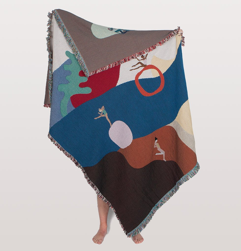 Orleans Throw by Slowdown Studio.  Designed by New York  based artist Grace Millar this stunning throw features strong athletic women on a beautiful landscape setting.