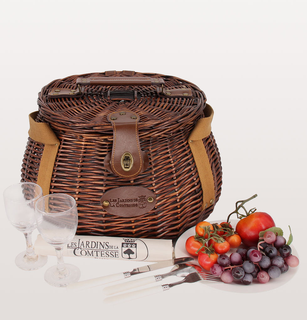 The Tuileries panier picnic hamper is perfect for chic couples. The canvas straps fit on your shoulder, so carrying your wicker picnic hamper is easy if you're walking, cycling or taking public transport. The two person set is insulated with china plates, glasses, cutlery, salt & pepper for the ultimate picnic basket.  £130 wagreen.co.uk