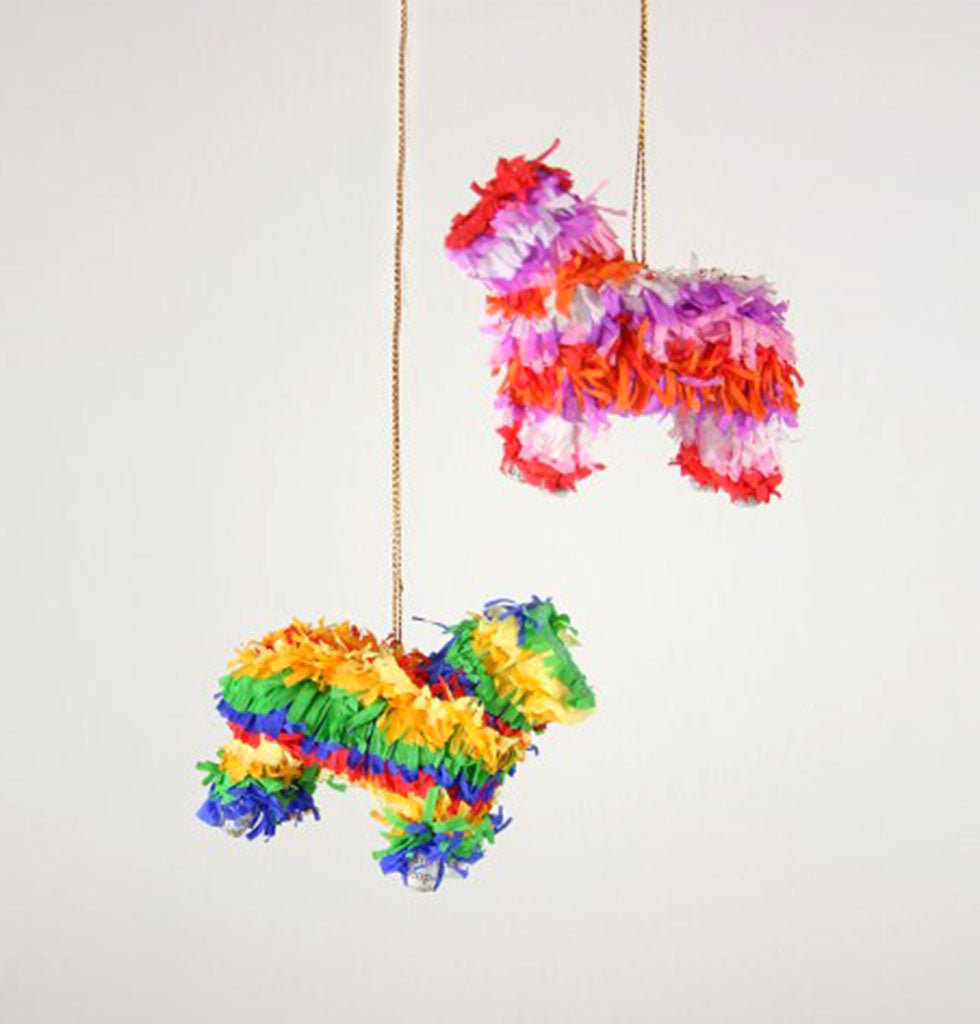 Traditional Mexican paper pinata Christmas tree decorations. Papier Mache cows are decorated in layers of coloured crepe paper to create this party game favourite.  Highly decorated with bright paper detail for Mexican inspired Christmas tree.