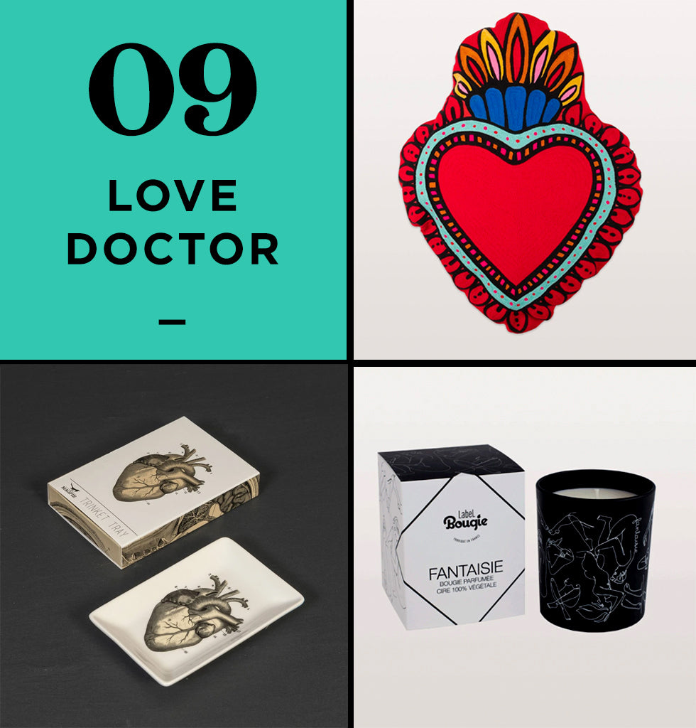 "HOME PERK UP PACK 9 | LOVE DOCTOR | Give someone your heart with this anatomical heart trinket tray, while the luxury Label Bougie scented candle will have you fantasising about your loved one. The cute Kitsch Kitchen red love heart cushion is for anyone who's so smitten, to show their loved one ""home is where the heart is"""