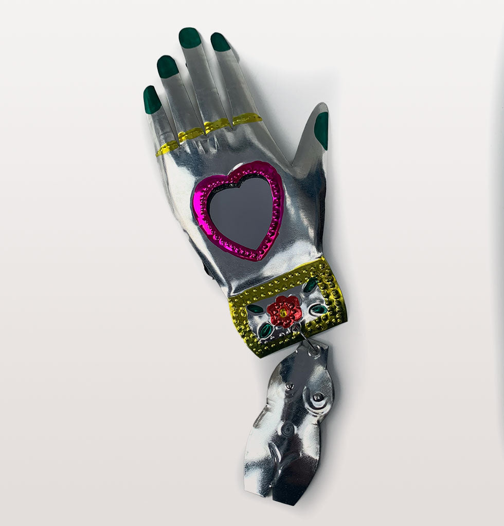 Pink heart and green nails Mexican miracle hand mirror. £21 wagreen.co.uk