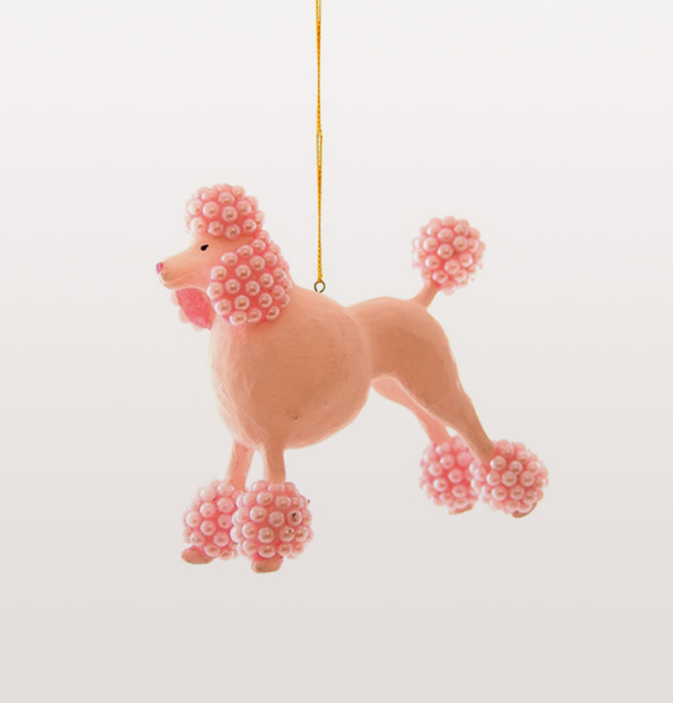 We love pink, we love poodles, we love Christmas!  This pink beaded poodle dog tree decoration is just the crazy addition to your tree you never knew you needed until this very moment... woof!