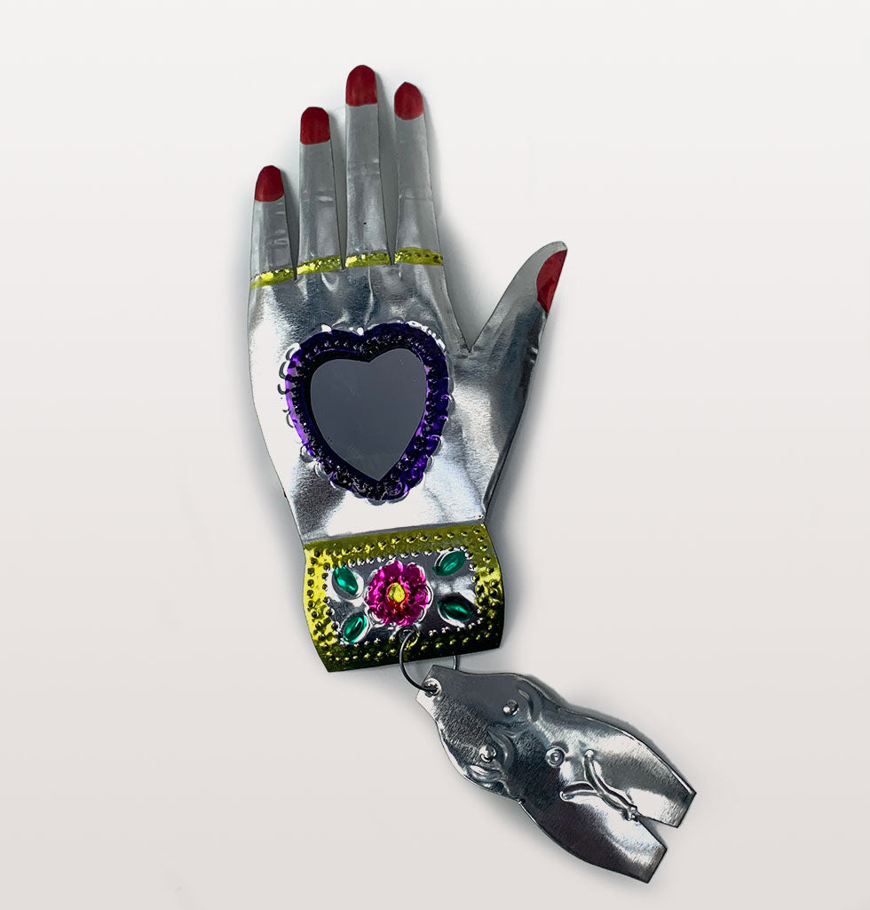 Purple heart and red nails Mexican miracle hand mirror. £21 wagreen.co.uk