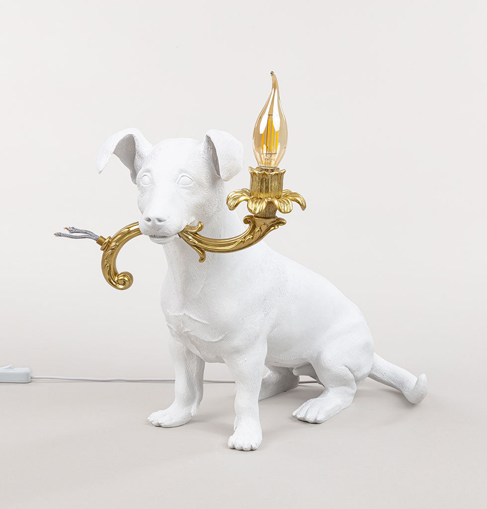 W.A.GREEN | SELETTI | Sit Rio! This fun character dog lamp is designed as a tribute to the much loved Jack Russell dog, Rio of the Seletti family.  Rio is quite the character and can be seen tearing around their design showroom in Italy. The life-size replica white dog lamp is sitting with the lamp of a gold chandelier arm, complete with torn wires proudly in his mouth.  Designed by Italian design legend, Marcantonio this fun lamp is sure to become your own family favourite. £255 wagreen.co.uk