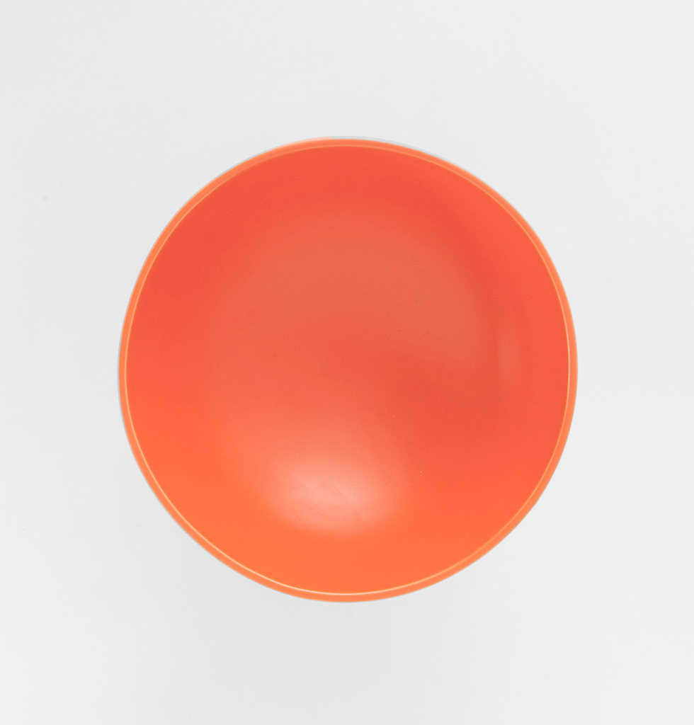 Top view of large bright orange contemporary fruit bowl