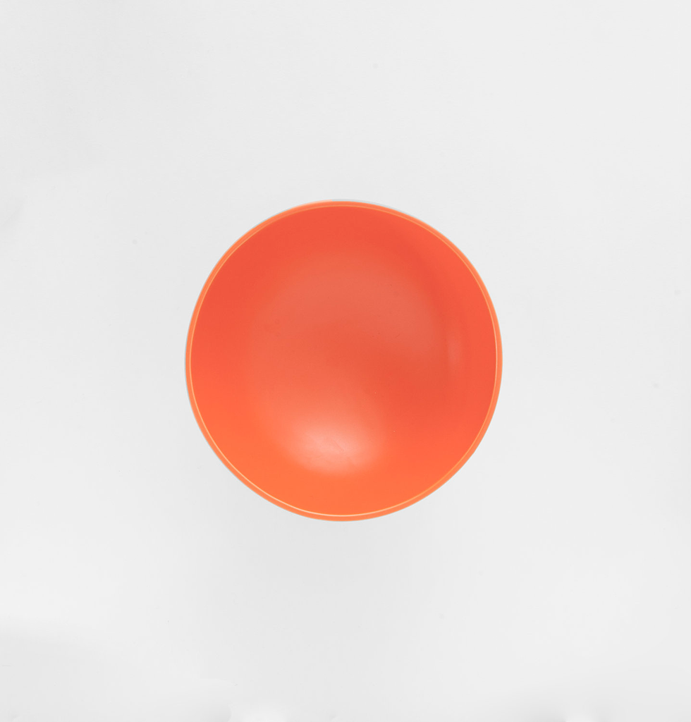 Top view of small orange trinket dish or bowl by Raawii