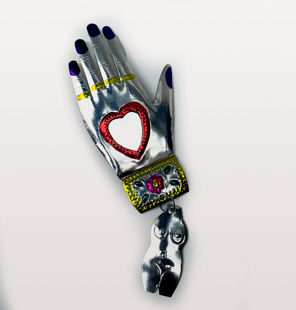 Red heart and purple nails Mexican miracle hand mirror. £21 wagreen.co.uk