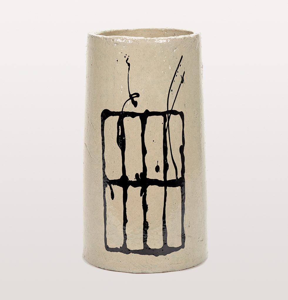 Large white tall vase with black painted grid design by Marie Michielssen at Serax