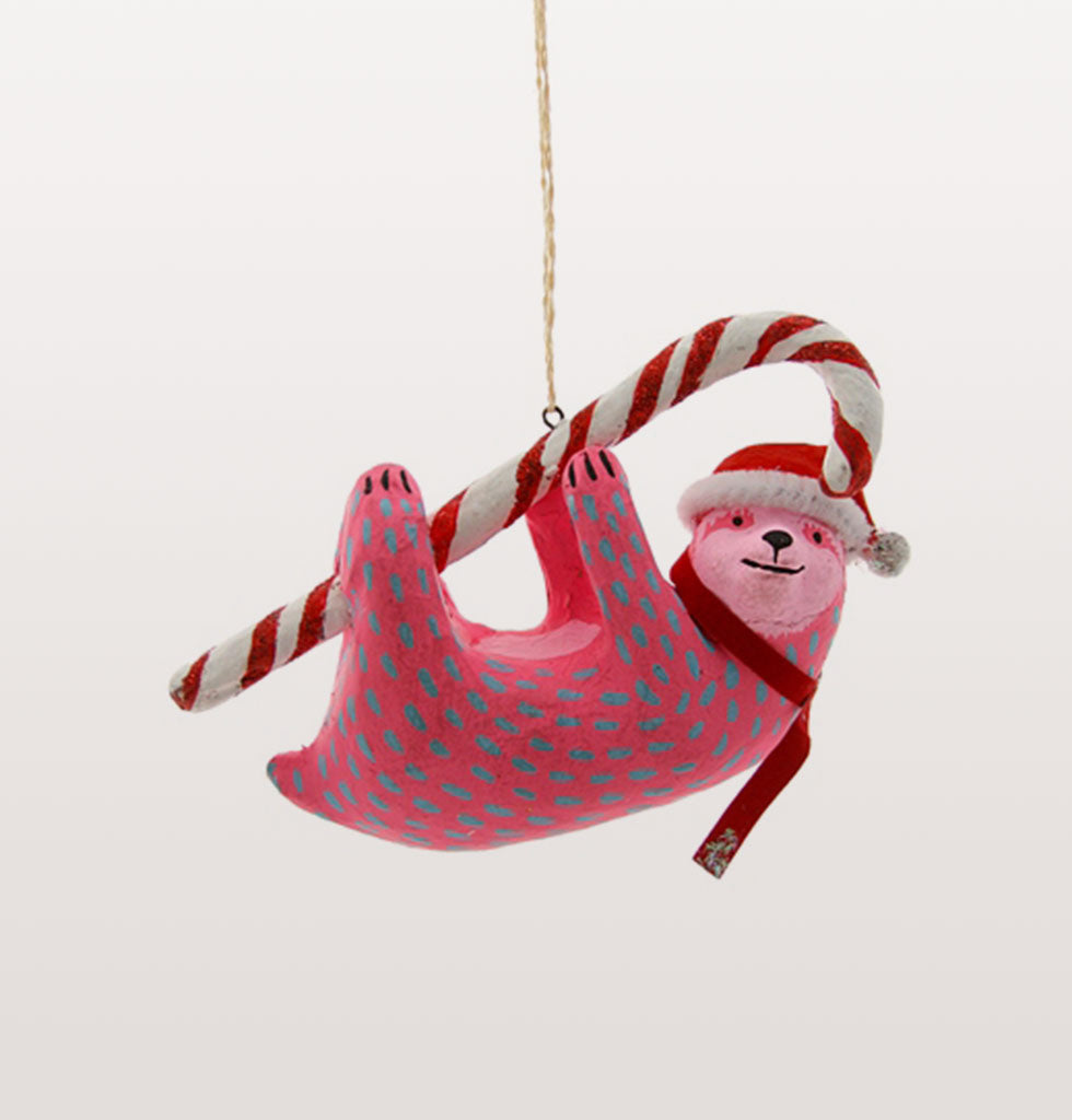 This Candy Cane Sloth tree decoration is just what your tree was missing. This pink and cheeky sloth is destined to become a festive family favourite. Hand painted neon plaster festive sloth decoration.