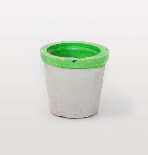 Concrete Candy, hand made concrete and Jesmonite. Terrazzo effect speckles with orange, yellow, blue and lime green rim. Succulent planter or flower pot.