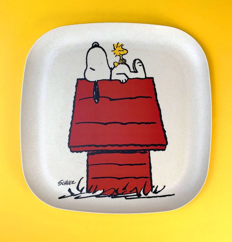 Fun and sustainable bamboo Snoopy drinks tray. Snoopy and Woodstock on the iconic red house from Peanuts cartoon